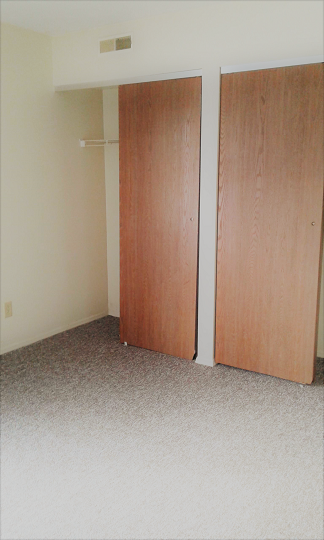 Large bedroom with two seperate closets